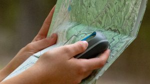 Hand with GPS and map